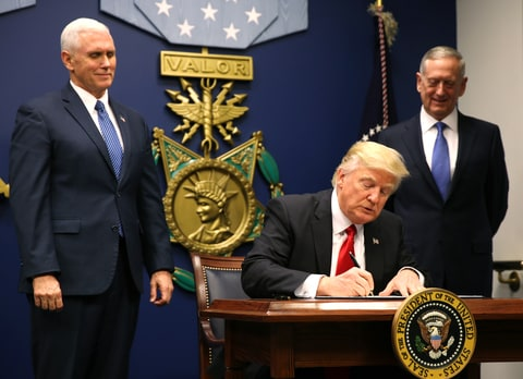 U.S. President Donald Trump signs an executive order he said would impose tighter vetting to prevent foreign terrorists from entering the United States at the Pentagon in Washington, U.S., January 27, 2017. The executive order signed by Trump imposes a four-month travel ban on refugees entering the United States and a 90-day hold on travelers from Syria, Iran and five other Muslim-majority countries