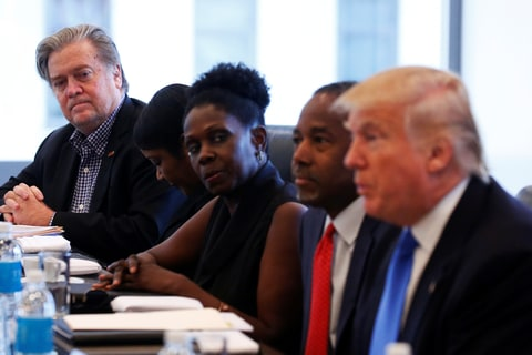 Stephen Bannon (L) CEO of Republican presidential nominee Donald Trump's (R) campaign is pictured during a round table with the Republican Leadership Initiative at Trump Tower in the Manhattan borough of New York, U.S., August 25, 2016.