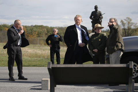 Republican U.S. presidential nominee Donald Trump (C) and campaign CEO Steve Bannon (R) listen to National Park Service Interpretive Park Ranger Caitlin Kostic (2nd R) on a brief visit to Gettysburg National Military Park in Gettysburg, Pennsylvania, U.S. October 22, 2016.