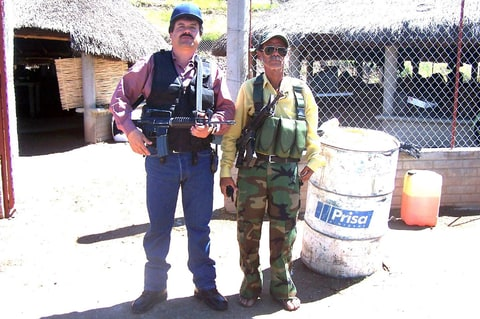 January 19, 2011Joaquin Guzman (L), the leader of Mexico's Sinaloa drug cartel, is seen next to an unidentified man in this undated handout photo found after a raid on a ranch, released to Reuters on January 18, 2011.