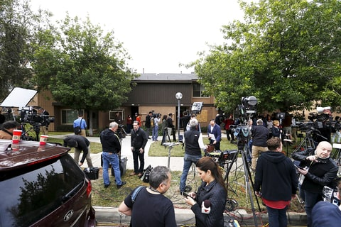 Journalists outside the home of shooting suspects Syed Rizwan Farook and Tashfeen Malik