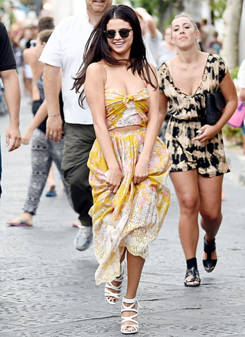selena gomez laughing in gold dress