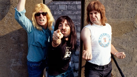 Parody English heavy metal band, Spinal Tap (L-R;  Michael McKean (David St. Hubbins), Harry Shearer (Derek Smalls), and Christopher Guest (Nigel Tufnel)), 1984. (Photo by Pete Cronin/Redferns/Getty Images)