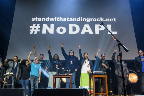 Time Reynolds and Dave Matthews stand with eh Standing Rock Indian Tribe on stage at the Stand With Standing Rock charity concert at DAR Constitution Hall in Washington, D.C.