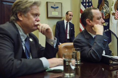 From left: Trump advisor Steve Bannon, advisor Stephen Miller and White House Chief of Staff Reince Priebus listen while US President Donald Trump speaks at the beginning of a meeting with lawmakers in the Roosevelt Room of the White House February 2, 2017 in Washington, DC.