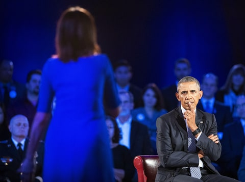 President Barack Obama listens to Taya Kyle speak