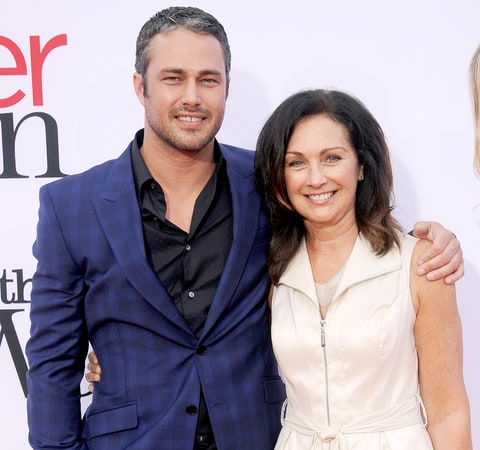 Taylor Kinney and mother Pamela Heisler arrive at the Los Angeles premiere of