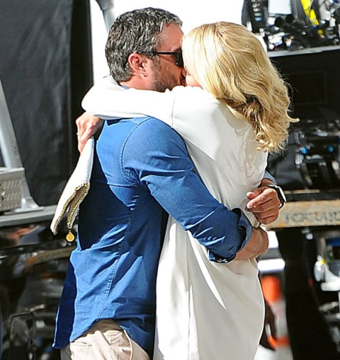 Taylor and Cam kissing on set