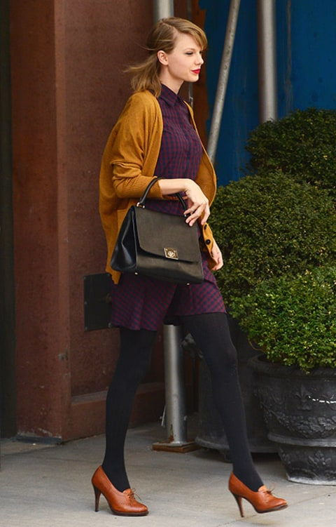 Taylor Swift gym and mustard sweater