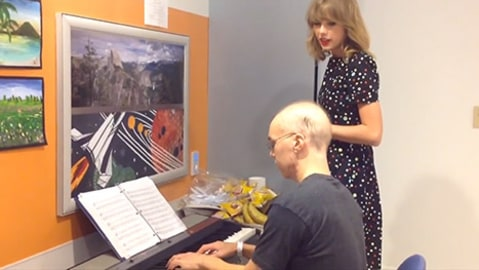 Taylor Swift singing to patient