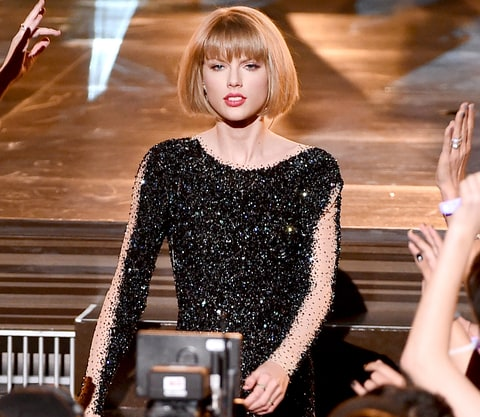 Taylor Swift performs on stage during The 58th GRAMMY Awards.