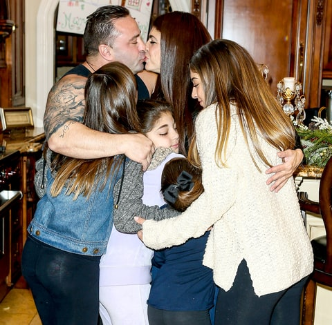Teresa received a big group hug from her husband, Joe Giudice, and her girls, Gia, Milania, Gabriella and Audriana on December 23.