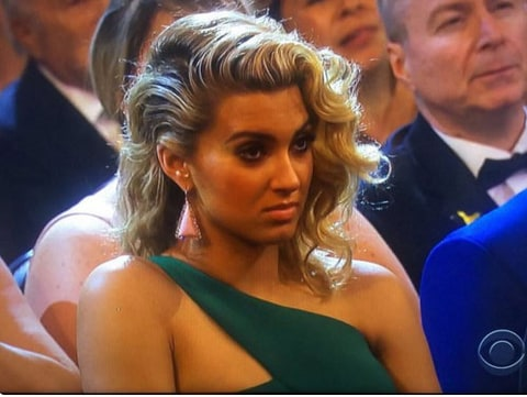 Tori Kelly looks unimpressed during Taylor Swift's Grammys 2016 speech