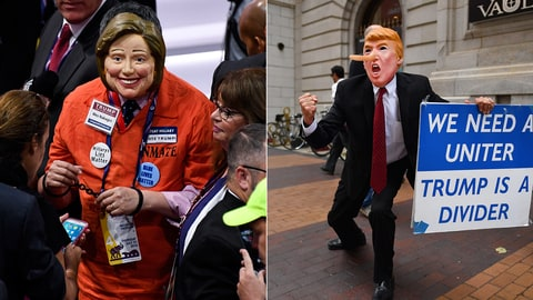 (left) A delegate deseed as Hillary Clinton in a prison jumpsuit walks the floor of the Quicken Loans Arena at the 2016 Republican National Convention in Cleveland, Ohio on Thursday July 201, 2016. (right)  A man wearing a trump mask walks through downtown on July 17, 2016 in Cleveland, Ohio.