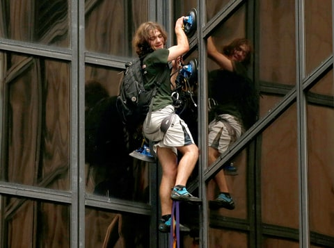 A man climbs the outside of Trump Tower in New York, U.S., August 10, 2016.