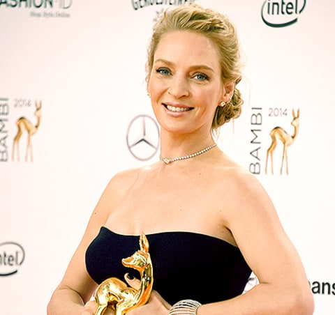 Uma Thurman poses with her award during Kryolan at the Bambi Awards ...