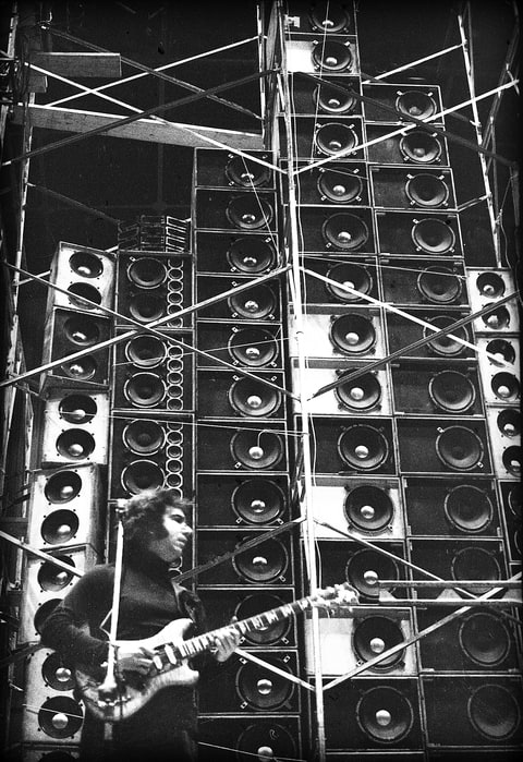 Jerry Garcia performing during the Grateful Dead's first concert with the Wall of Sound. 03/23/1974 at the Cow Palace in Daly City, California. Photographer: Peter Simon