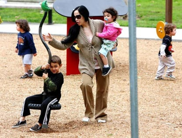 Plays With Her Kids at Park