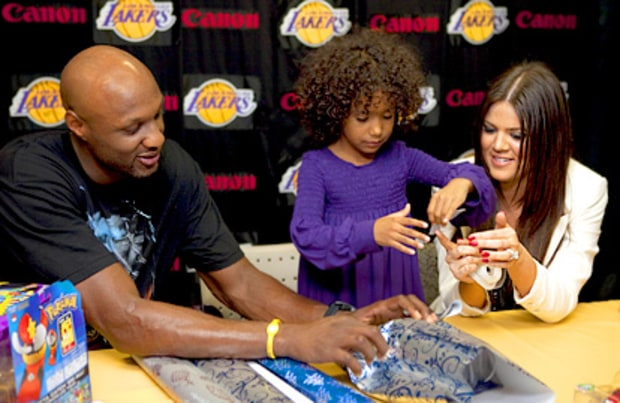 Khloe and Lamar with Child