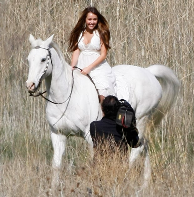 miley cyrus celebrities riding horses us weekly