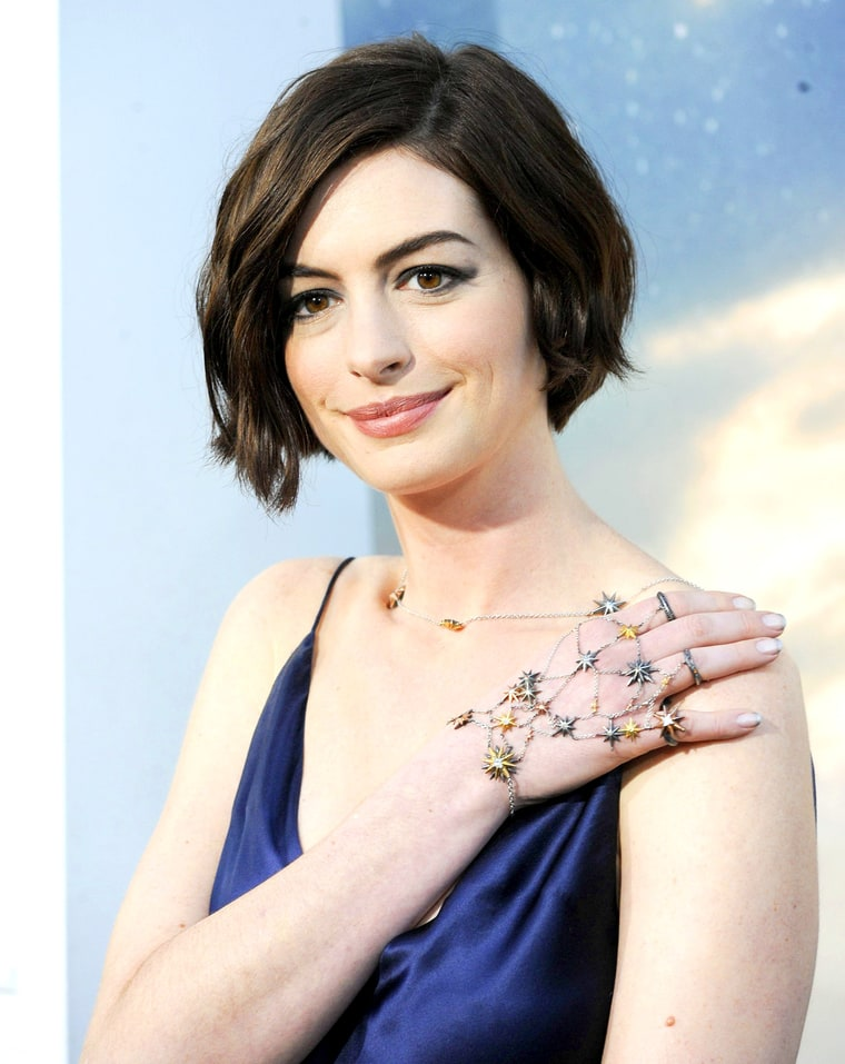 Anne Hathaway Rocked Starry Hand Jewels for Interstellar ... Anne Hathaway