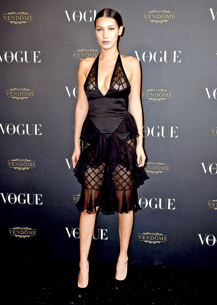 Bella Hadid Reveals Nipple Piercing In Sheer Dress Red