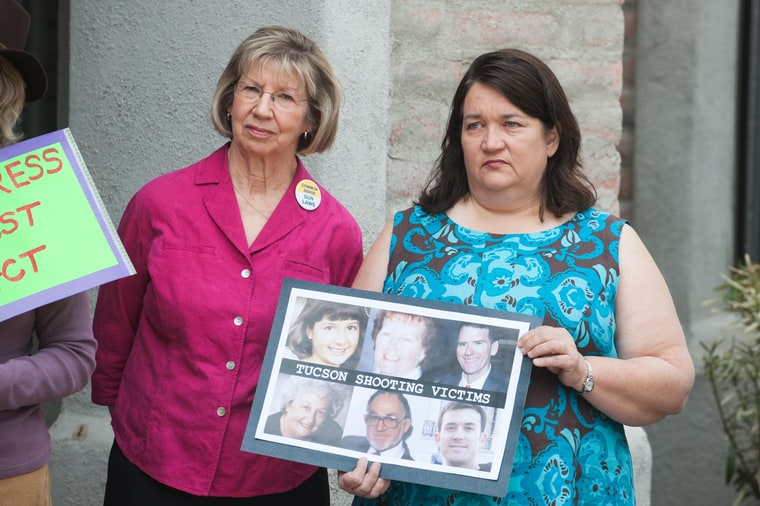 5th March 2013. Tucson shooting victims PAM SIMON, left, and MARY REED, right, attended an event held outside the Tucson, Ariz. office of Sen. J. Flake (R-Ariz.) calling for a non-partisan approval of universal background checks for firearm purchases. The event was organized by several groups including the Tucson Community Committee Against Gun Violence, Mayors Against Illegal Guns and The National Coalition to Stop Gun Violence.