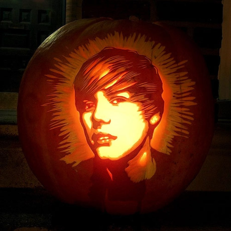 Photos pumpkins carved to look like rock stars rolling