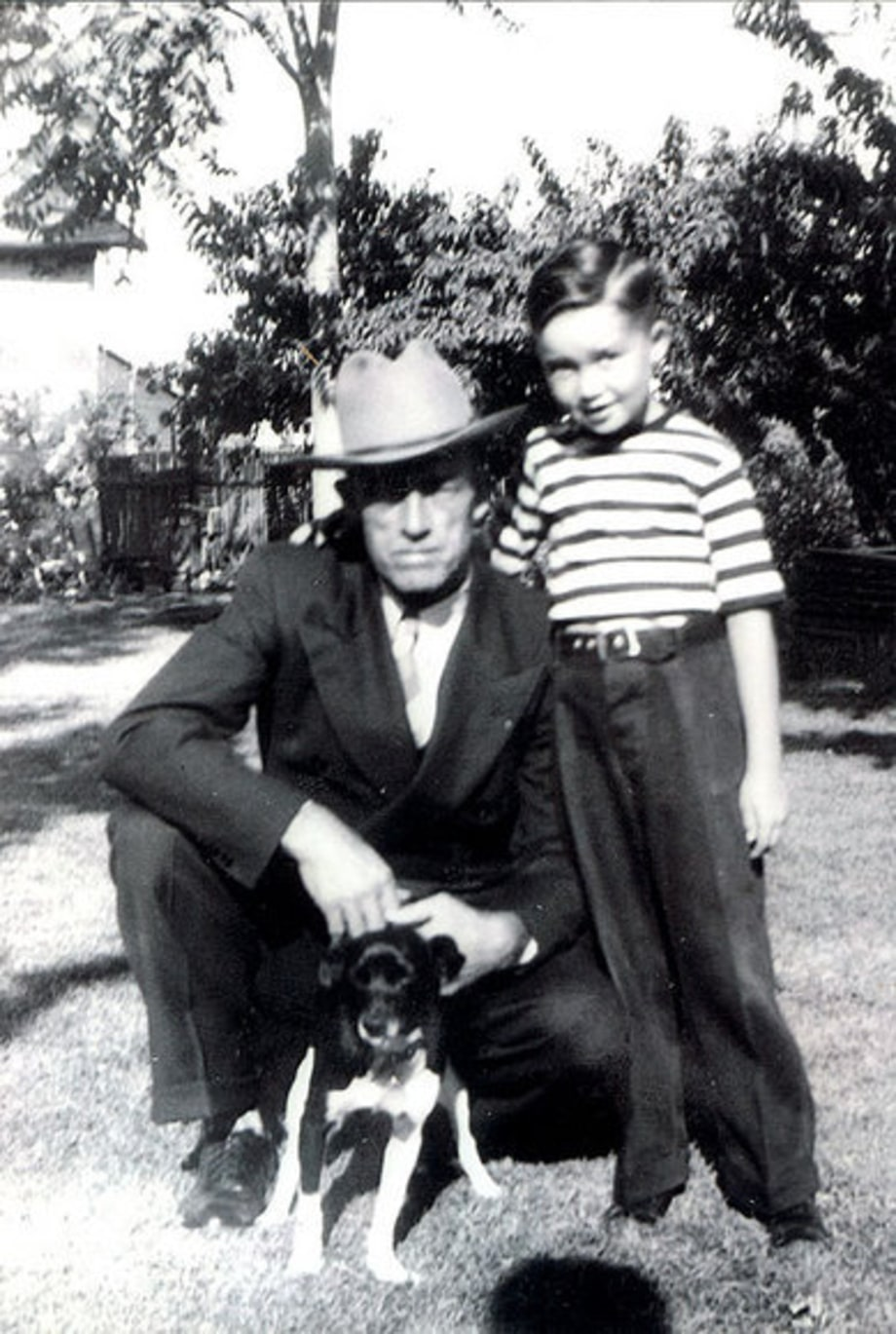Merle Haggard: 1944: with his father and dog
