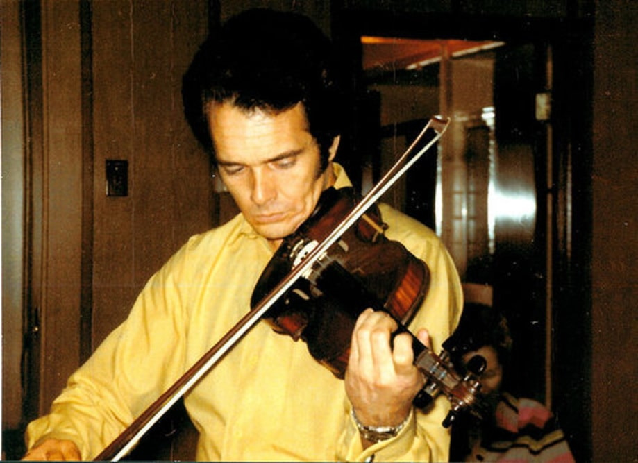 Merle Haggard: 1970: playing fiddle