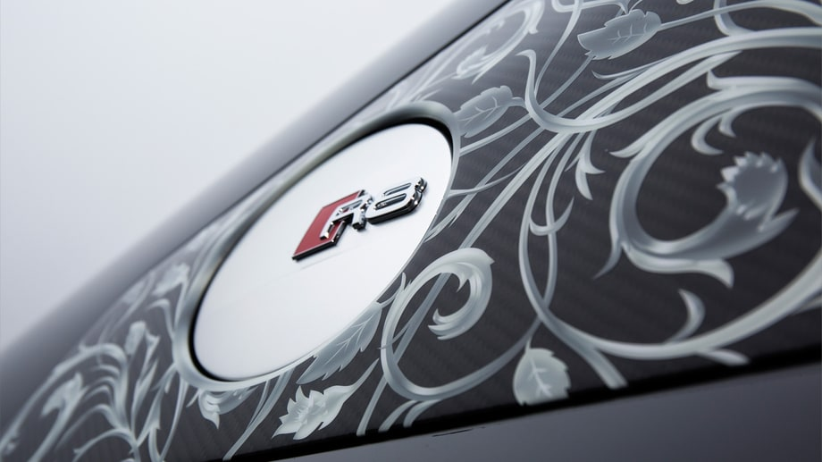 It has ornate patterns on the side intakes, around the filler cap and on the wing mirrors