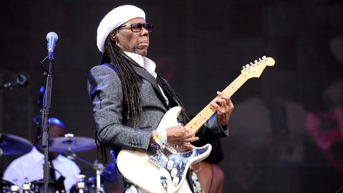 Chic's Nile Rodgers pauses Glastonbury set to tell crowd he's cancer