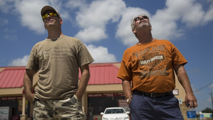 Counter Jade Helm Observers Pete Lanteri And Larry Fortney Watch A Suious Airplane Flying Above Camp Swift Military Base In Bastrop Texas