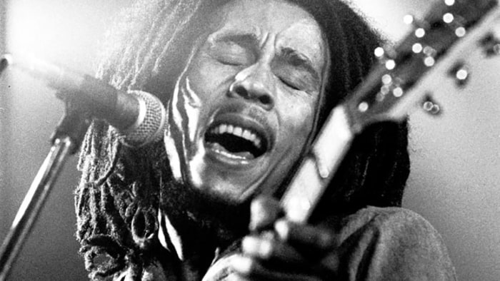 Bob Marley performs live on stage with the Wailers in 1976 in Voorburg, Holland. Credit: Gijsbert Hanekroot/Redferns