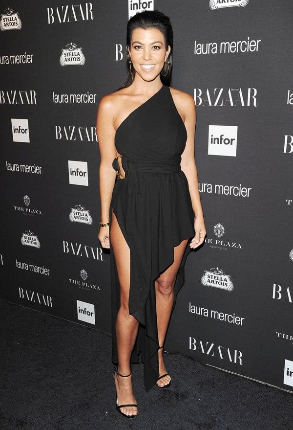 Kourtney Kardashian Shows Off Major Leg In Daring Black