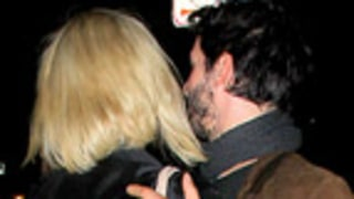 Charlize Theron, Keanu Reeves Kiss, Embrace