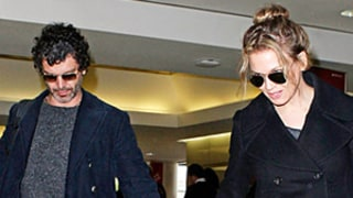 Renee Zellweger Kisses New Man Doyle Bramhall II at LAX