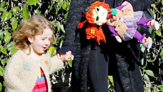 Alyson Hannigan's Daughter Satyana Carries Lookalike Doll During Holiday Outing