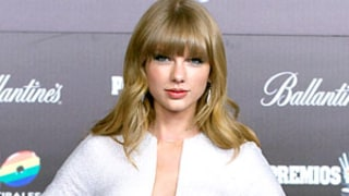 Taylor Swift Looks Sexy in Plunging White Dress, Says She
