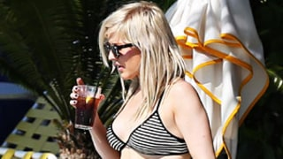Ellie Goulding Shows Off Toned Abs in Striped Bikini Top, High-Waisted Shorts