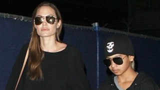 Angelina Jolie Rocks Tight Black Leather Pants at Airport With Maddox