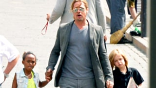 Brad Pitt, Shiloh and Zahara Jolie-Pitt Hold Hands During Outing in Russia: Picture