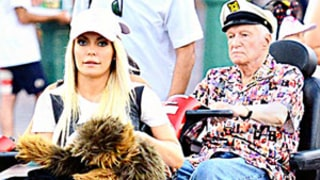 Hugh Hefner, 87, Wife Crystal Harris, 27, Ride Motorized Scooters at Disneyland: Pic