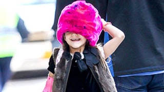 Suri Cruise Wears Fur Vest, Pink Fur Hat to Match Arm Cast on Way to School
