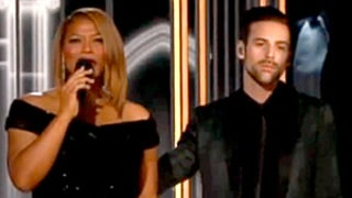 Queen Latifah Pulled Aside By Ryan Lewis for Madonna's Grammys Entrance