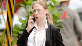 Chelsea Clinton Sports Growing Baby Bump In White Blouse, Business Attire: Pregnant Picture