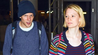 Jesse Eisenberg, Girlfriend Mia Wasikowska Hold Hands, Kiss at LAX: Photos