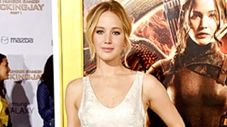 Jennifer Lawrence Has a Cinderella Moment in Voluminous Silver Gown, Plus More Stars at The Hunger Games Premiere