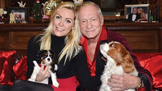 Hugh Hefner, Crystal Harris Snuggle Up to Their Dogs on Adorable 2014 Holiday Card