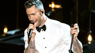 Adam Levine Tosses Mic, Hits Fan on the Head, She Says It's